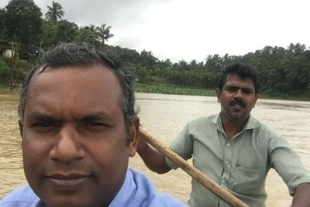 Fr. Saji Kappikuzhy RCJ, St. Thomas Quasi Province Novice Master, navigating through the streets on a boat.