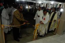 Fr. Herman Abcede cutting the ceremonial ribbon.