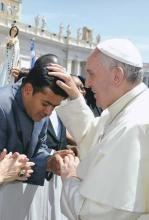 Fr. Roy receives papal blessing before begins his mission in Angola