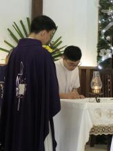 Bro. Gabriel Motol signing the formula of first profession, while Fr. Orville Cajigal, the Superior of St. Matthew Province, witnesses it.