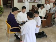 Bro. Gabriel Motol Jr. professing his vows as a Rogationist for the first time, in the hands of Fr. Orville Cajigal, Superior of St. Matthew Province.