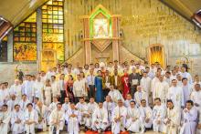 The group picture of the Bishop, concelebrants, parents and the new priests.