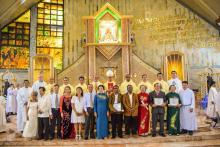 The new priests with their parents and the Bishop